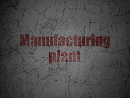 manufacturing plant: Manufacuring concept: Red Manufacturing Plant on grunge textured concrete wall background
