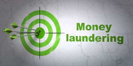 Success banking concept: arrows hitting the center of target, Green Money Laundering on wall background Stock Photo