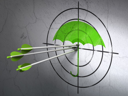 success security: Success security concept: arrows hitting the center of Green Umbrella target on wall background Stock Photo