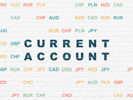 current account: Currency concept: Painted blue text Current Account on White Brick wall background with Currency