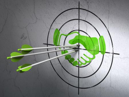 bullseye: Success finance concept: arrows hitting the center of Green Handshake target on wall background Stock Photo