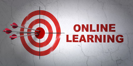 hitting a wall: Success Learning concept: arrows hitting the center of target, Red Online Learning on wall background