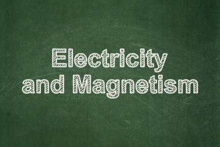 magnetism: Science concept: text Electricity And Magnetism on Green chalkboard background
