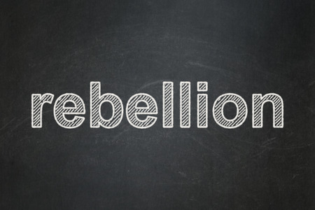 rebellion: Politics concept: text Rebellion on Black chalkboard background