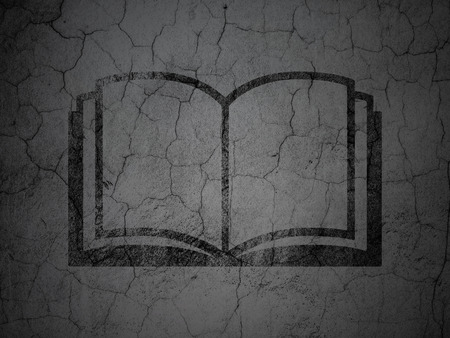 black textured background: Learning concept: Black Book on grunge textured concrete wall background