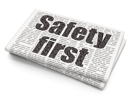 safety first: Protection concept: Pixelated black text Safety First on Newspaper background