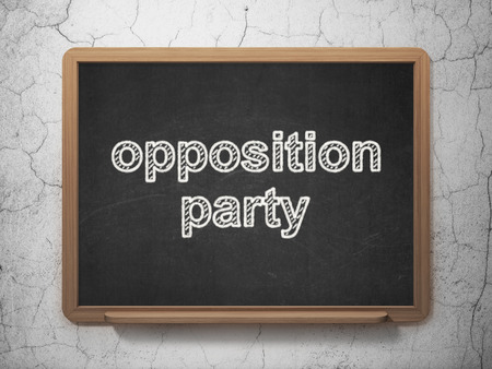 opposition: Politics concept: text Opposition Party on Black chalkboard on grunge wall background Stock Photo