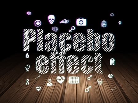 placebo: Health concept: Glowing text Placebo Effect,  Hand Drawn Medicine Icons in grunge dark room with Wooden Floor, black background