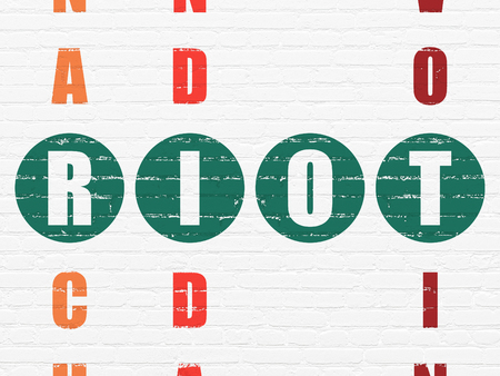 crossword: Politics concept: Painted green word Riot in solving Crossword Puzzle