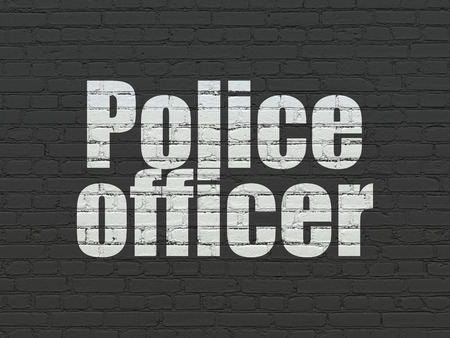 criminal act: Law concept: Painted white text Police Officer on Black Brick wall background Stock Photo