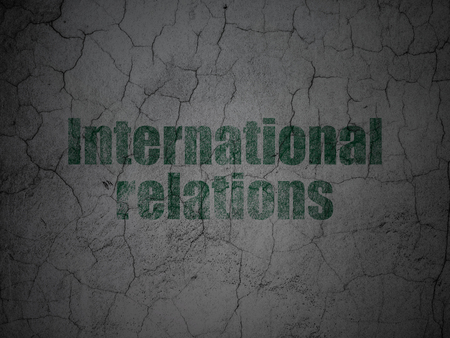 dictatorship: Political concept: Green International Relations on grunge textured concrete wall background Stock Photo