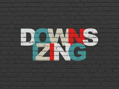 downsizing: Business concept: Painted multicolor text Downsizing on Black Brick wall background Stock Photo
