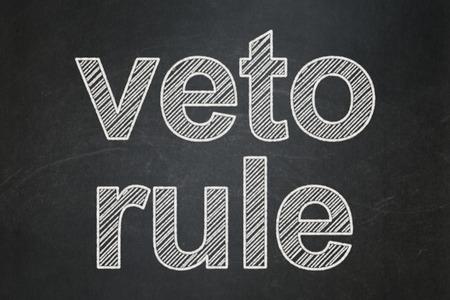 veto: Politics concept: text Veto Rule on Black chalkboard background Stock Photo