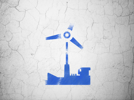 blue grey: Manufacuring concept: Blue Windmill on textured concrete wall background Stock Photo
