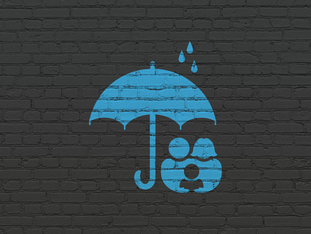 black family: Safety concept: Painted blue Family And Umbrella icon on Black Brick wall background Stock Photo