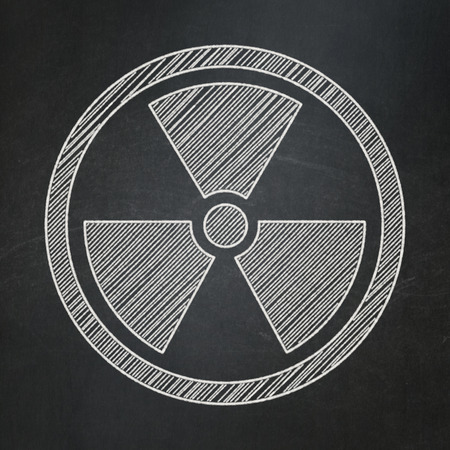 caution chemistry: Science concept: Radiation icon on Black chalkboard background