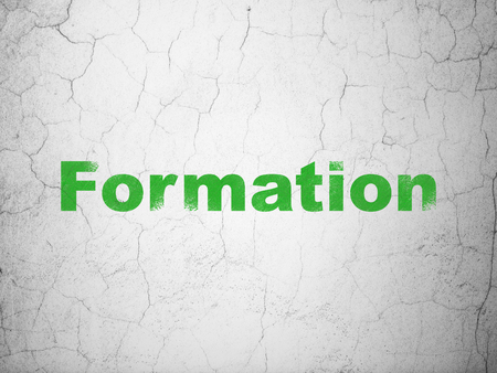 formation: Studying concept: Green Formation on textured concrete wall background