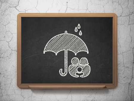 black family: Protection concept: Family And Umbrella icon on Black chalkboard on grunge wall background