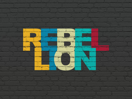 rebellion: Political concept: Painted multicolor text Rebellion on Black Brick wall background