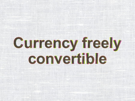 freely: Currency concept: CMYK Currency freely Convertible on linen fabric texture background