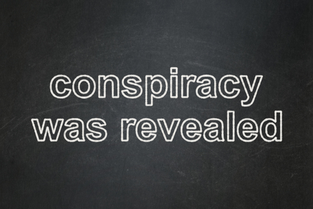 revealed: Politics concept: text Conspiracy Was Revealed on Black chalkboard background