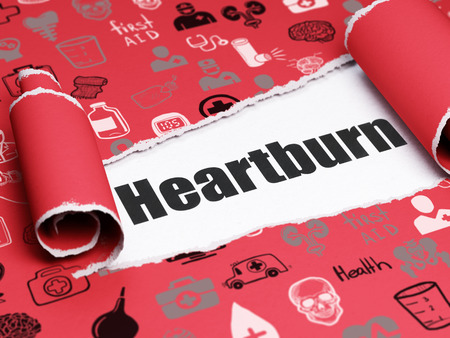 heartburn: Medicine concept: black text Heartburn under the curled piece of Red torn paper with  Hand Drawn Medicine Icons Stock Photo