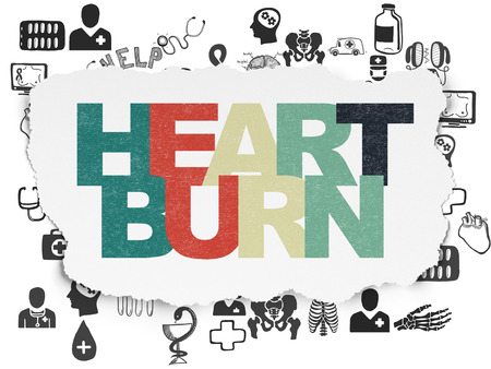 heartburn: Medicine concept: Painted multicolor text Heartburn on Torn Paper background with  Hand Drawn Medicine Icons
