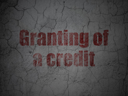 granting: Banking concept: Red Granting of A credit on grunge textured concrete wall background