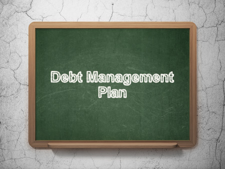 debt management: Business concept: text Debt Management Plan on Green chalkboard on grunge wall background