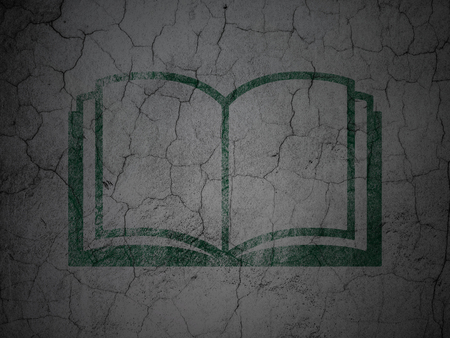 green book: Education concept: Green Book on grunge textured concrete wall background Stock Photo