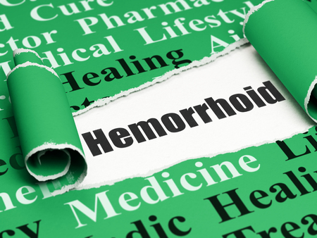 hemorrhoid: Health concept: black text Hemorrhoid under the curled piece of Green torn paper with  Tag Cloud