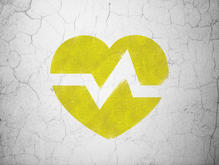 heart health: Health concept: Yellow Heart on textured concrete wall background