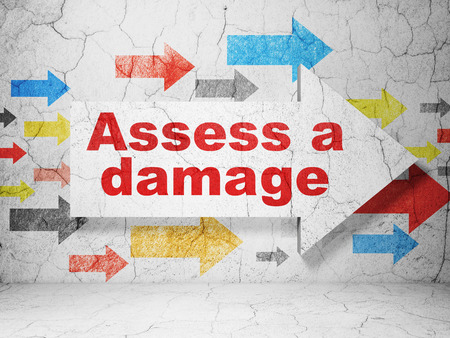 assess: Insurance concept:  arrow with Assess A Damage on grunge textured concrete wall background