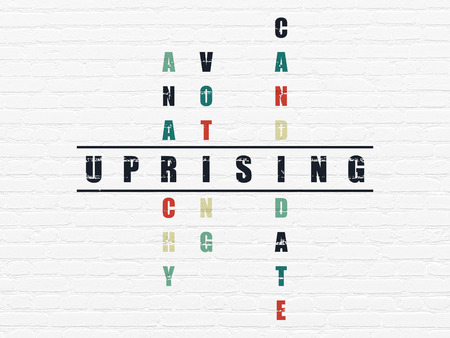 uprising: Political concept: Painted black word Uprising in solving Crossword Puzzle