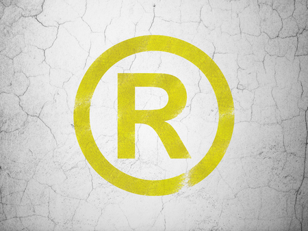 r regulation: Law concept: Yellow Registered on textured concrete wall background Stock Photo
