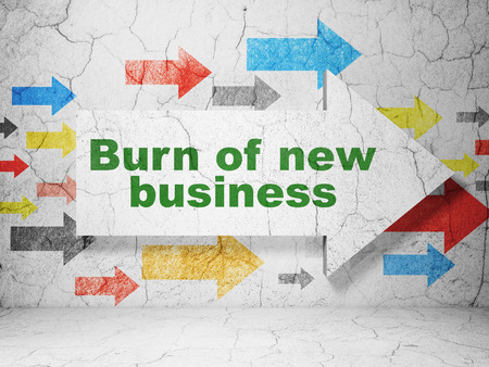 new arrow: Finance concept:  arrow with Burn Of new Business on grunge textured concrete wall background