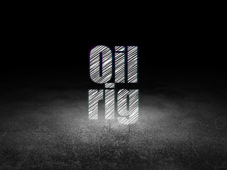 dirty room: Manufacuring concept: Glowing text Oil Rig in grunge dark room with Dirty Floor, black background Stock Photo