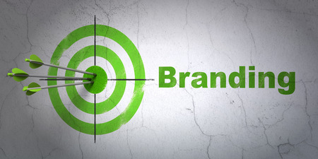 hitting a wall: Success marketing concept: arrows hitting the center of target, Green Branding on wall background