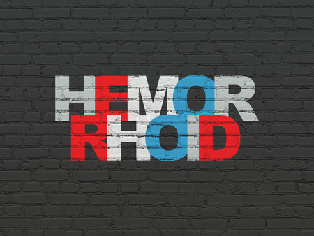 hemorrhoid: Medicine concept: Painted multicolor text Hemorrhoid on Black Brick wall background