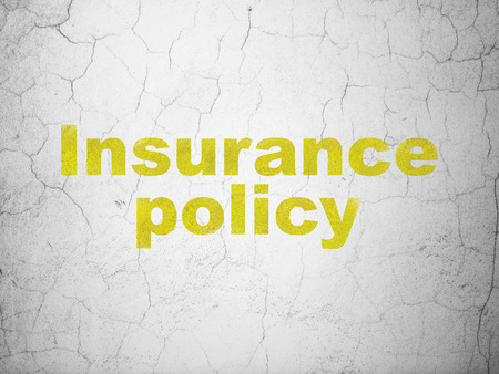 insurance policy: Insurance concept: Yellow Insurance Policy on textured concrete wall background