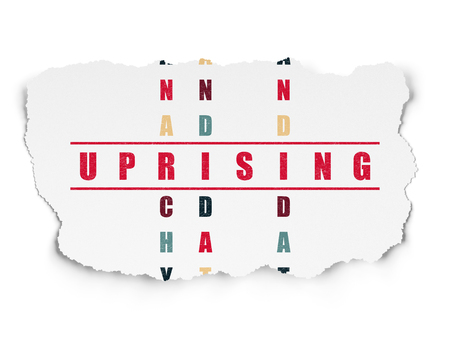 uprising: Political concept: Painted red word Uprising in solving Crossword Puzzle on Torn Paper background Stock Photo