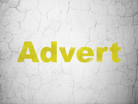 advert: Advertising concept: Yellow Advert on textured concrete wall background
