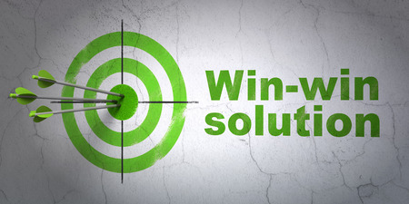 hitting a wall: Success business concept: arrows hitting the center of target, Green Win-win Solution on wall background Stock Photo