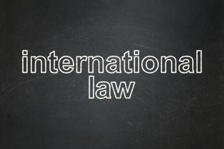 international law: Political concept: text International Law on Black chalkboard background