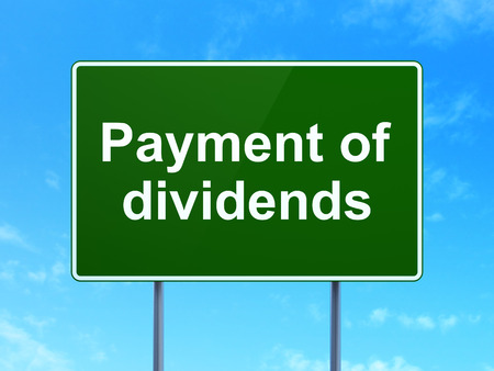 dividends: Money concept: Payment Of Dividends on green road highway sign, clear blue sky background, 3d render Stock Photo