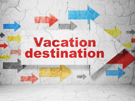 destination: Travel concept:  arrow with Vacation Destination on grunge textured concrete wall background Stock Photo