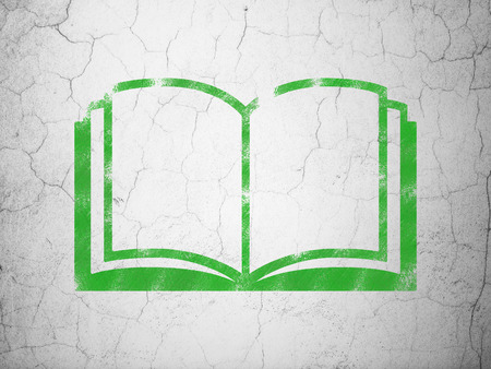 green book: Studying concept: Green Book on textured concrete wall background