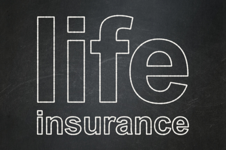 insurance concepts: Insurance concept: text Life Insurance on Black chalkboard background