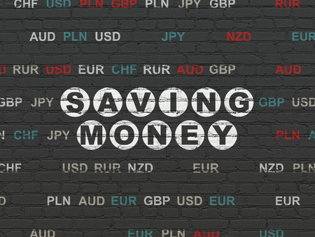 finance concept: Finance concept: Painted white text Saving Money on Black Brick wall background with Currency Stock Photo
