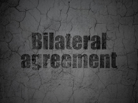 bilateral: Insurance concept: Black Bilateral Agreement on grunge textured concrete wall background